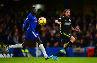 Tiémoué Bakayoko of Chelsea in action with Ezequiel Schelotto of Brighton during the EPL - Premier League match between Chelsea and Brighton and Hove Albion at Stamford Bridge, London, England on 26 December 2017. Photo by PRiME Media Images.