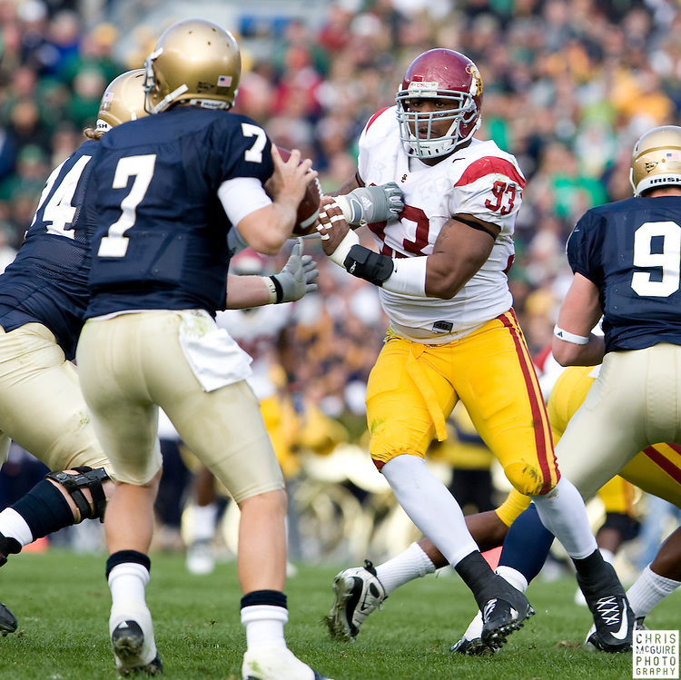 10/17/09 - South Bend, IN:  USC defensive end Everson Griffen pressures Notre Dame quarterback Jimmy Clausen at Notre Dame Stadium on Saturday.  USC won the game 34-27 to extend its win streak over Notre Dame to 8 games.  Photo by Christopher McGuire.