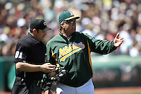 OAKLAND, CA - MAY 23:  Home plate umpire Brian Knight #91 and manager Bob Geren #17 of the Oakland Athletics argue during the game against the San Francisco Giants at the Oakland-Alameda County Coliseum on May 23, 2010 in Oakland, California. Photo by Brad Mangin