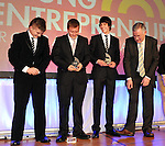 Ryan Dowling, CBS The Green, Tralee, left drops his trophy after being presented at the Young Entrepreneur of the Year 2012. Photo: Don MacMonagle