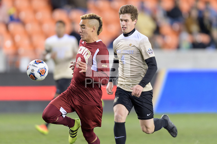 Houston, TX Friday, December 9, 2016:  Andre Shinyashiki (9) of the Denver Pioneers gains control of the ball with Kevin Politz (4) of the Wake Forest Demon Deacons in pursuit at the NCAA Men's Soccer Semifinals at BBVA Compass Stadium in Houston Texas.