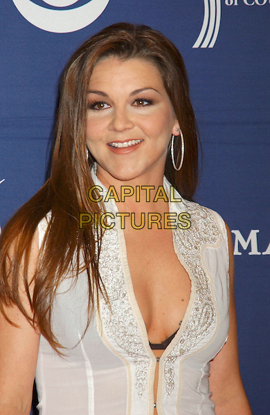 GRETCHEN WILSON.The 40th Annual Academy of Country Music Awards (ACM) held at Mandalay Bay Resort & Casino, Las Vegas, Nevada, USA, 17 May 2005..half length white shirt cleavage.Ref: ADM.www.capitalpictures.com.sales@capitalpictures.com.©Laura Farr/AdMedia/Capital Pictures.