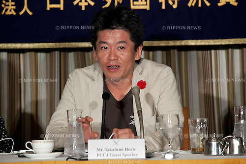 Tokyo, Japan - Takafumi Horie, Founder of SNS Inc. and Former President of Livedoor, speaks about his wishes to support the Japanese economy and people during a press conference at The Foreign Correspondents' Club of Japan, June 5, 2013. Horie was released from prison on March 28, after 21 moths of a 30 months sentence, he was guilty and incarcerated in 2011 for fabricating financial reports and spreading false information to investors. But he continues to assert his innocence. (Photo by Rodrigo Reyes Marin/AFLO)
