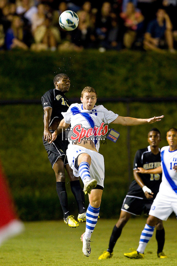 Nick Palodichuk (11) of the Duke Blue Devils battles for a jump ball with Chris Duvall (18) of the Wake Forest Demon Deacons at Spry Soccer Stadium on September 21, 2012 in Winston-Salem, North Carolina.  The Demon Deacons and the Blue Devils battled to a 0-0 tie in 2 overtimes.  (Brian Westerholt/Sports On Film)
