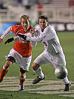 Clemson's Justin Moore (l) and New Mexico's Lars Loeseth chase the ball. The University of New Mexico Lobos defeated the Clemson University Tigers 2-1 in a Men's College Cup Semifinal at SAS Stadium in Cary, NC, Friday, December 9, 2005.