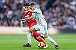 Lucas Vazquez (r) of Real Madrid fights for the ball with Ever Maximiliano Banega of Sevilla FC during the La Liga 2017-18 match between Real Madrid and Sevilla FC at Santiago Bernabeu Stadium on 09 December 2017 in Madrid, Spain. Photo by Diego Souto / Power Sport Images