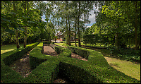 BNPS.co.uk (01202 558833)<br /> Pic: Bedfords/BNPS<br /> <br /> The stylish gardens still contain the tracks.<br /> <br /> Well chuffed - The Queen's former Sandringham Railway Station office comes on the market...<br /> <br /> A luxury home that used to be the ticket office for a Royal railway station has gone on the market - giving the new owner the chance to be neighbours with the Queen.<br /> <br /> Ashbee House formed part of the station for the tiny hamlet of Wolferton, which is within the grounds of the Queen's Sandringham Estate.<br /> <br /> The Royal Family alighted there when they visited their grand Norfolk residence two miles away every Christmas.<br /> <br /> But in 1969 the Queen agreed for the station to close in order to save costs. Ashbee House was converted into a five bedroom home 15 years ago and is now up for sale for &pound;1.495m.