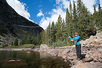 A woman casts at Lake of the Falls in the Absaroka-Beartooth Wilderness Area in southwest Montana.