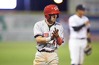 Claudio Finol (4) of the Greeneville Reds claps his hands during the game against the Pulaski Yankees at Calfee Park on June 23, 2018 in Pulaski, Virginia. The Reds defeated the Yankees 6-5.  (Brian Westerholt/Four Seam Images)