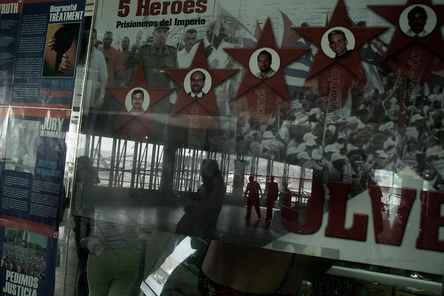 Havana (Cuba). September 2006..Vedado. Supermarket. Poster of the Cuban five. The Cuban Five are Gerardo Hernández, Antonio Guerrero, Ramón Labañino, Fernando Gonzáles, and René Gonzáles. After being arrested in Miami, Florida in September 1998, they were indicted by the U.S. government on 26 different counts ranging from using false identification to espionage and conspiracy to commit murder. In June 2001, they were convicted of all 26 counts by a U.S. federal court in Miami and in December sentenced to varying terms in maximum-security prison: two consecutive life terms for Hernández, life for Guerrero and Labañino, 19 years for Fernando Gonzáles, and 15 years for René Gonzáles.