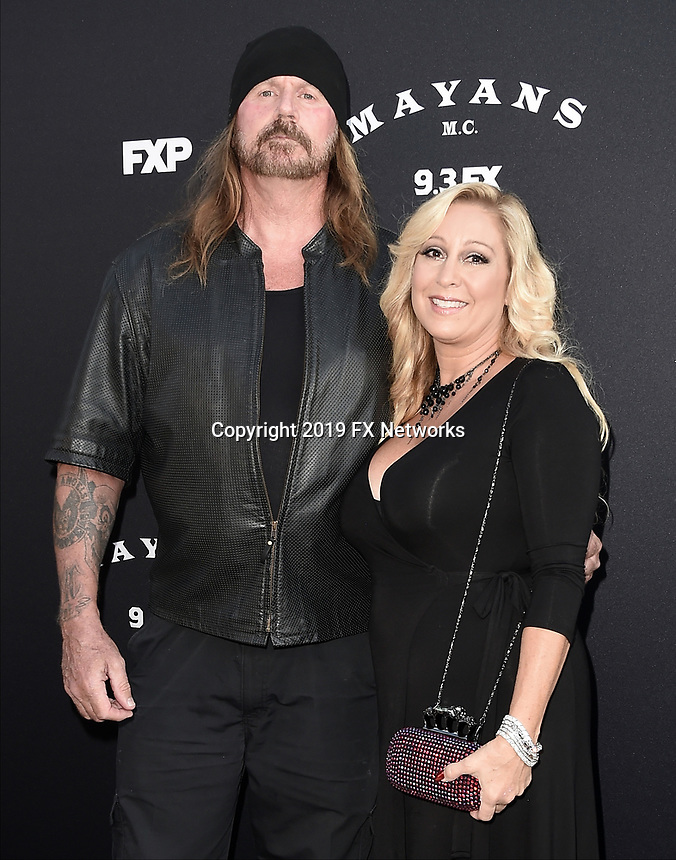 "LOS ANGELES - AUGUST 27: Rusty Coones and Katherine Coones attend the season two red carpet premiere of FX's ""Mayans M.C"" at the ArcLight Dome on August 27, 2019 in Los Angeles, California. (Photo by Scott Kirkland/FX/PictureGroup)"