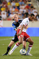 Tim Ward (20) of the San Jose Earthquakes looks to slow Thierry Henry (14) of the New York Red Bulls. The New York Red Bulls defeated the San Jose Earthquakes 2-0 during a Major League Soccer (MLS) match at Red Bull Arena in Harrison, NJ, on August 28, 2010.