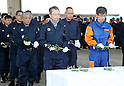 March 11, 2016, Tokyo, Japan - Police officers offer chrysanthemums for the tsunami and earthquake victims after they searched remains of missing people at Namie in Fukushima prefecture near the crippled TEPCO's nuclear plant on Friday, March 11, 2016 on the fifth anniversary of the East Japan Great Earthquake.  (Photo by Yoshio Tsunoda/AFLO) LWX -ytd-