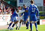St Johnstone v Motherwell...11.09.10  .Nicholas Blackman fends off Chris Millar and Dave Mackay.Picture by Graeme Hart..Copyright Perthshire Picture Agency.Tel: 01738 623350  Mobile: 07990 594431