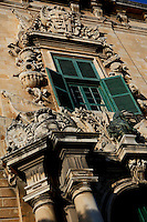 Detail of ornate window, Auberge de Castille (Il-Berga ta' Kastilja), 1571, Valletta, Malta, pictured on June 7, 2008, in the morning.  The Republic of Malta consists of seven islands in the Mediterranean Sea of which Malta, Gozo and Comino have been inhabited since c.5,200 BC. Nine of Malta's important historical monuments are UNESCO World Heritage Sites, including  the capital city, Valletta, also known as the Fortress City. Built in the late 16th century and mainly Baroque in style it is named after its founder Jean Parisot de Valette (c.1494-1568), Grand Master of the Order of St John. The Knights of St John built an auberge, or inn, for each nationality of knight who passed through Malta. This one, for Castilians, was designed by Girolamo Cassar, and re-modelled in 1741, probably by Andrea Belli. It is now the Prime Minister's office. Picture by Manuel Cohen.