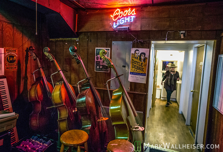 Base fiddles line the back wall offstage at the Station Inn in Nashville, Tennessee.  The Station in is known for nightly bluegrass, roots and acoustical music in the Music City.