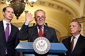 United States Senate Minority Leader Chuck Schumer (Democrat of New York) speaks to reporters outside the US Senate Chamber following the Democrats' weekly luncheon caucus in the US Capitol in Washington, DC on Tuesday, September 19, 2017.  The Democratic leadership is advocating against the passage of the Graham-Cassidy Act that would replace parts of the Affordable Care Act (also known as ObamaCare) with block grants for the individual states.  From left to right:  US Senator Ron Wyden (Democrat of Oregon), Leader Schumer, and US Senator Dick Durbin (Democrat of Illinois).<br /> Credit: Ron Sachs / CNP