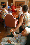 Prayer time at an Alzheimer's patients live-in residence for Alzheimer's and dementia related  patients.