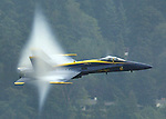 "Lt. Cmdr. Dan ""Dino"" Martin, Lead Solo of the U.S. Navy Flight Demostration Team, flies his F-18 fighter through a a vapor bubble his jet created on Saturday, August 2, 2003 at the 53rd General Motors Cup on Lake Washington in Seattle . Jim Bryant Photo"