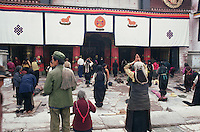 Pilgrims from distant parts finally arrive in front of the Jokhang Temple, Lhasa.