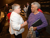 NWA Democrat-Gazette/ANDY SHUPE<br /> Longtime educator Faye Jones (left) greets Peggy Taylor Lewis, who was one of the first black students to graduate from Fayetteville High School, Thursday, Oct. 11, 2018, before the start of a presentation by the four Fayetteville Public Schools Hall of Honor inductees in the Performing Arts Center on the Fayetteville High School campus.Also inducted were pediatric dentist James Hunt and beloved educator George Spencer.