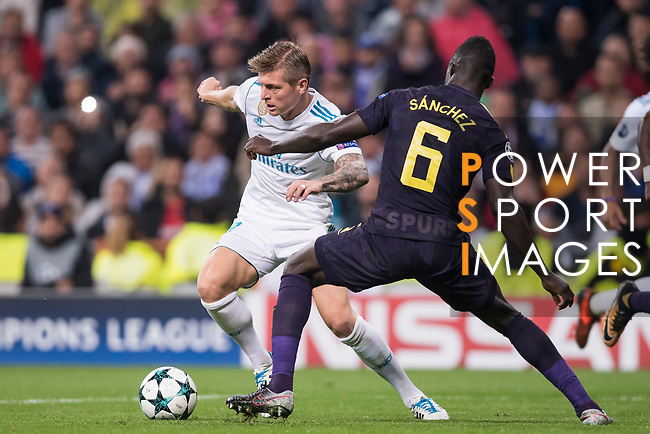Toni Kroos of Real Madrid (L) fights for the ball with Davinson Sanchez of Tottenham Hotspur FC (R) during the UEFA Champions League 2017-18 match between Real Madrid and Tottenham Hotspur FC at Estadio Santiago Bernabeu on 17 October 2017 in Madrid, Spain. Photo by Diego Gonzalez / Power Sport Images