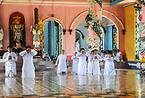 VIETNAM, Cao Dai Temple in the City of Tay Ninh, Prayers indoors wearing white clothes