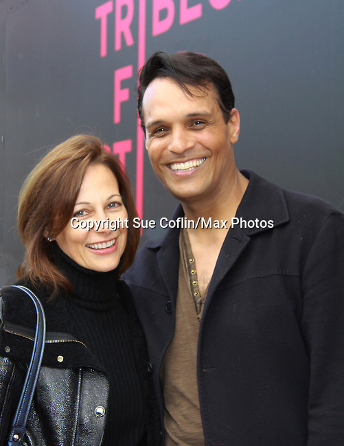 """Another World's Bronson Picket """"Diego Santana"""" and As The World Turns' Scott Guthrie"""" poses with his wife Lynn Snowden as he stars in at The private Industry Screening of """"The Southside"""", A Lany Film Tribute to Robert Areizaga, Jr. on the red carpet on February 27, 2012 at Tribeca Cinemas, New York City, New York.  (Photo by Sue Coflin/Max Photos)"""