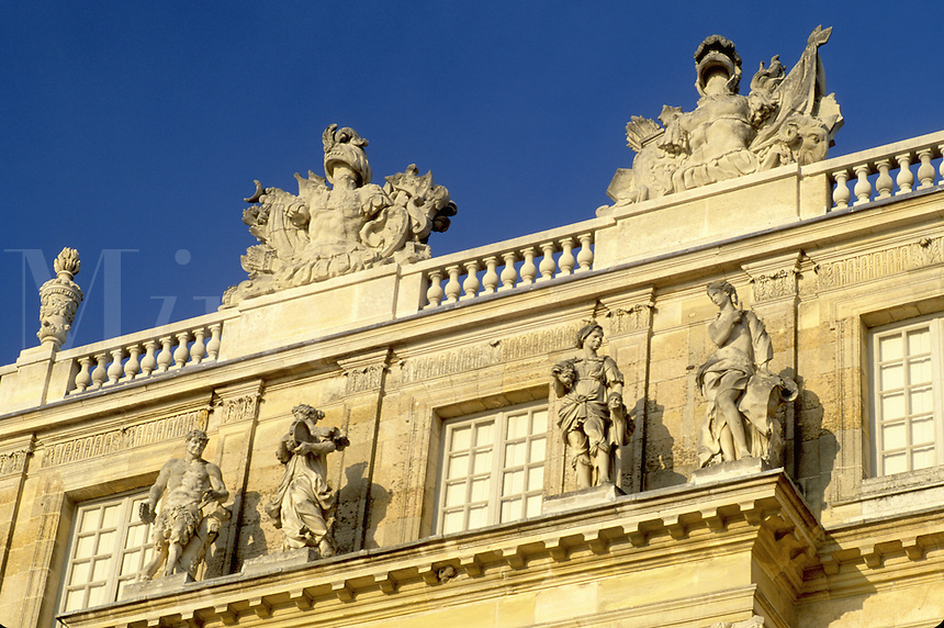 Versailles, France, Yvelines, Ile de France, Paris, Europe, Ornate statues on top of Chateau de Versailles.