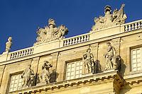 Versailles, France, Yvelines, Ile de France, Paris, Europe, Ornate statues on top of Chateau de Versailles.