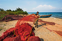 """Ishimalanga, Fisher-Woman, Lake Tanganyika, Democratic Republic of the Congo, 2014<br /> Statistics show that a woman is raped every minute in the Congo. These atrocious attacks are considered an on-going """"weapon of war"""" committed by rebels and even local police and militants. The women and young girls in these areas find themselves most vulnerable when simply performing the necessary but isolating chore of gathering wood and water in the forest for their families. Often they become impregnated and are then abandoned by their husbands and family.<br /> Ishimalanga Nabugamba suffered physical abuse, lost most of her family members and all her property during the war. The NGO, Women for Women, has helped train thousands of women in work skills programs in this area to help regain their dignity through financial stability and a sense of community with micro-loans and the merry-go-round program where women pool their money together and take turns receiving the pot at the end of the month. Ishimalanga, shown here with her fishing boat on Lake Tanganyika where she learned to fish, bought a large fishing net with her proceeds. She intends to pass this skill on to her children and she now has a sense of purpose and hope in her life."""