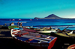 Fishing boats in El Medano against the background of the red mountain,Tenerife, Canary Islands, Spain