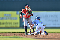 Mississippi Braves shortstop Dansby Swanson (5) fields the ball and applies the tag as Chesny Young (3) slides in safely during a game against the Tennessee Smokies at Smokies Stadium on May 7, 2016 in Kodak, Tennessee. The Smokies defeated the Braves 5-3. (Tony Farlow/Four Seam Images)