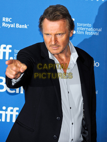 Liam Neeson<br /> &quot;Third Person&quot; Press Conference  - 2013 Toronto International Film Festival held at TIFF Bell Lightbox, Toronto, Ontario, Canada.<br /> September 10th, 2013<br /> half length suit jacket hand finger pointing looks angry upset black blue shirt stubble facial hair  <br /> CAP/ADM/BPC<br /> &copy;Brent Perniac/AdMedia/Capital Pictures