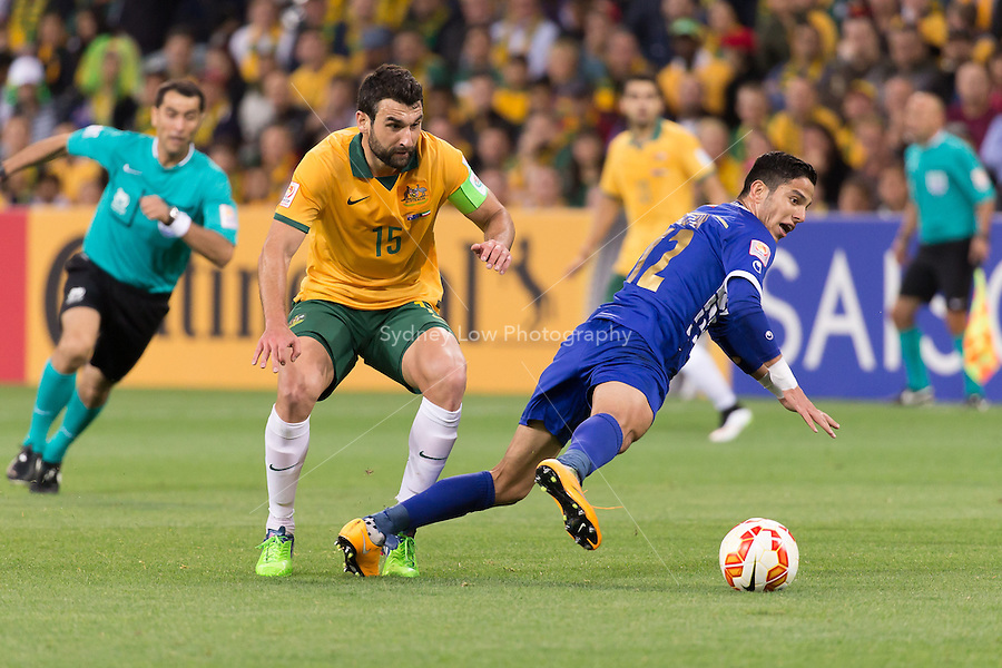 Mile JEDINAK of Australia fouls SULTAN ALENEZI of Kuwait in match 1 of the 2015 AFC Asian Cup at the Melbourne Rectangular Stadium on 9 January 2015. Australia def Kuwait 4-1