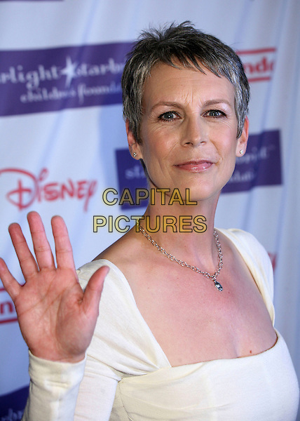 "JAMIE LEE CURTIS.Starlight Starbright Foundation's ""A Stellar Night Gala"" 2007 at the Beverly Hilton Hotel, Beverly Hills, California , USA, 23 March 2007..portrait headshot hand waving.CAP/ADM/BP.©Byron Purvis/AdMedia/Capital Pictures."