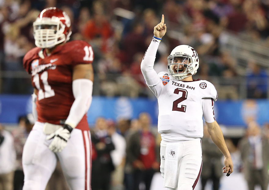 Jan 4, 2013; Arlington, TX, USA; Texas A&M Aggies quarterback Johnny Manziel (2) celebrates a touchdown that was scored in the third quarter against the Oklahoma Sooners during the Cotton Bowl at Cowboys Stadium.  Mandatory Credit: Tim Heitman-USA TODAY Sports