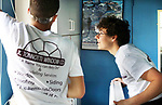 WATERBURY CT. 17 May 2019-051719SV03-From left, Chris Aceves, 17, of Meriden and Derek Strillacci, 18 of Southington install windows with Tonnotti Windows at a home in Waterbury Friday. The students from Wilcox Tech. are part of an apprenticeship program.<br /> Steven Valenti Republican-American