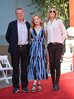 LOS ANGELES, CA. November 3, 2016: Jessica Chastain with directors John Madden &amp; Kathryn Bigelow at hand and footprint ceremony for actress Jessica Chastain at the TCL Chinese Theatre, Hollywood.<br /> Picture: Paul Smith/Featureflash/SilverHub 0208 004 5359/ 07711 972644 Editors@silverhubmedia.com