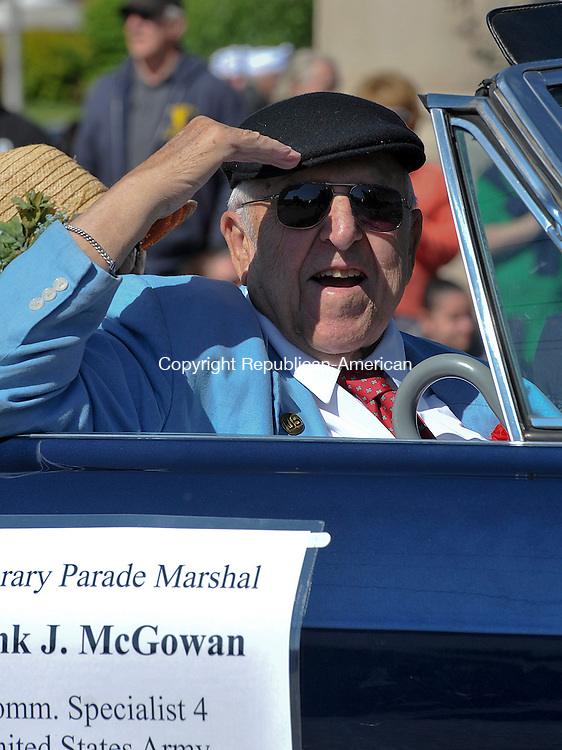 TORRINGTON, CT 27 MAY 2013--052713JS02- Honorary parade marshal Frank J. McGowan salutes to the crowd as he takes part in the annual Torrington Memorial Day parade on Monday. McGowan served as a Communications Specialist 4 in the United States Army. .Jim Shannon Republican American