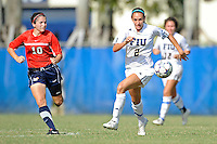 2 October 2011:  FIU's Chelsea Leiva (2) moves the ball upfield while being pursued by South Alabama's Clarissa Hernandez (10) in the second half as the FIU Golden Panthers defeated the University of South Alabama Jaguars, 2-0, at University Park Stadium in Miami, Florida.