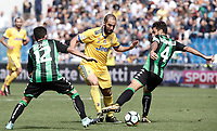 Calcio, Serie A: Reggio Emilia, Mapei stadium, 17 settembre 2017.<br /> Juventus' Gonzalo Higuain (c) in action with Sassuolo's Francesco Manganelli (r) and Stefano Sensi (l) during the Italian Serie A football match between Sassuolo and Juventus at Reggio Emilia's Mapei stadium, September 17, 2017.<br /> UPDATE IMAGES PRESS/Isabella Bonotto