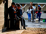 LOUISVILLE, KENTUCKY - APRIL 29: Exercise riders relax, grab a cup of coffee and share some gossip during a break between sets at Churchill Downs in Louisville, Kentucky on April 29, 2019. Scott Serio/Eclipse Sportswire/CSM