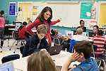 November 15, 2011. Mooresville, NC.. Ms. Thompson helps Zachary Shiver, a 4th grader at East Mooresville Intermediate School, with a math tutorial on his school issued laptop. Much of the class consists of computer based exercises which allows the teacher to help students individually.. The Mooresville school system has become nationally known for being on the cutting edge of using technology as an educational tool. Starting in 3rd grade, each student is issued their own laptop that they will use in class and at home to further their learning.