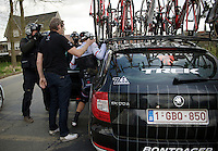 A bruised Fabian Cancellara (SUI/TREK Factory Racing) is assisted into the teamcar by DS Dirk Demol after having crashed on the Haaghoek just earlier in the race. He is forced to abandon the race <br /> with 2 transverse process fractures in 2 vertebrae bones of the lower back. Painful exit out of the Classics Season for Spartacus.<br /> <br /> 58th E3 Harelbeke 2015