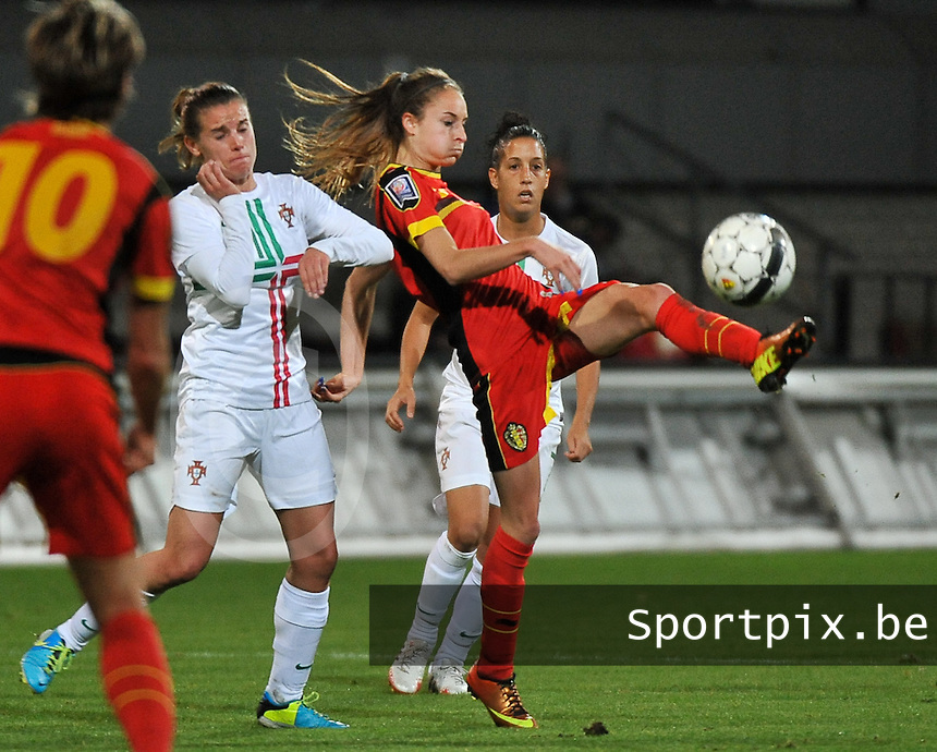 20131031 - ANTWERPEN , BELGIUM : Belgian Tessa Wullaert (9) pictured with Portugese Pisco (left) during the female soccer match between Belgium and Portugal , on the fourth matchday in group 5 of the UEFA qualifying round to the FIFA Women World Cup in Canada 2015 at Het Kiel stadium , Antwerp . Thursday 31st October 2013. PHOTO DAVID CATRY