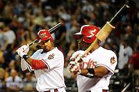 Jun. 22, 2010; Phoenix, AZ, USA; Arizona Diamondbacks outfielders Chris Young (left) and Justin Upton warm up in the eighth inning against the New York Yankees at Chase Field. The Yankees defeated the Diamondbacks 9-3. Mandatory Credit: Mark J. Rebilas-