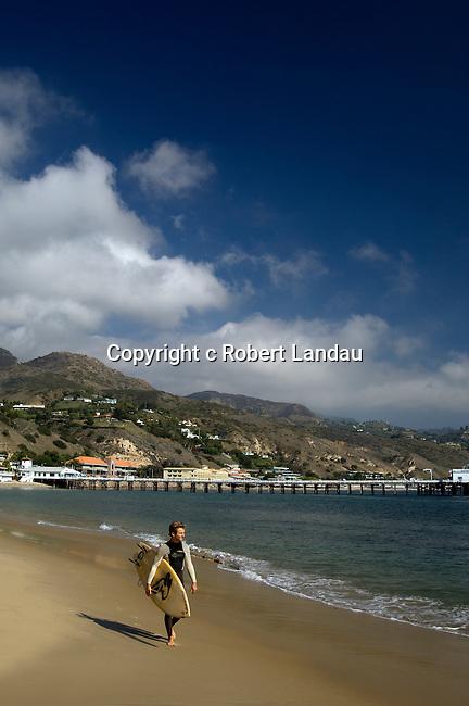 Surfer on Malibu Beach Near Pier