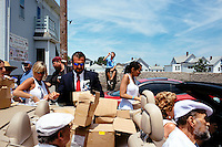 Participants get materials to hand out during the Sunday Procession of St. Peter's Fiesta in Gloucester, Massachusetts, USA.
