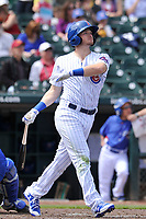 Iowa Cubs second baseman Ian Happ (8) launches a home run during a game against the Round Rock Express at Principal Park on April 16, 2017 in Des  Moines, Iowa.  The Cubs won 6-3.  (Dennis Hubbard/Four Seam Images)